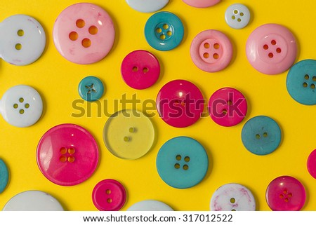 Many colorful sewing buttons texture background