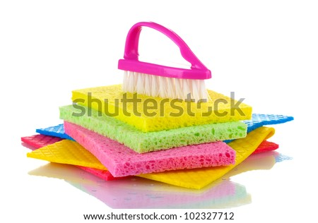 Many colorful sponges and brush for housework isolated on white