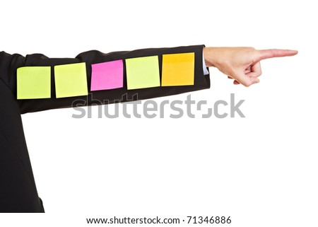 Many colorful sticky notes on business arm pointing to the right - stock photo