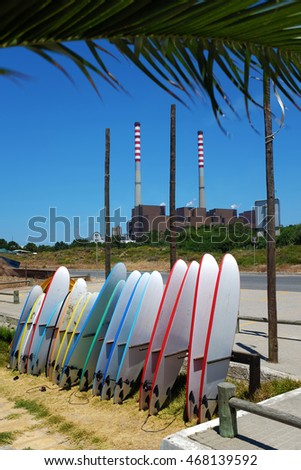 Many colorful surfboards standing together in S. Torpes beach, Portugal