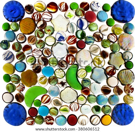 Many colorful transparent glass marbles isolated on white background - stock photo