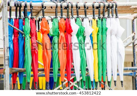 Many colorful umbrellas hanging.