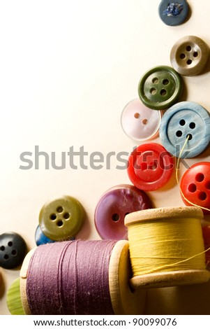 Many-coloured buttons and bobbins - stock photo