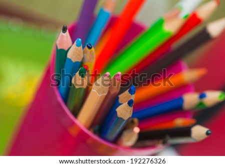 many coloured pencils standing in a box