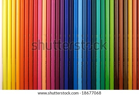 Many coloured pencils together in a row