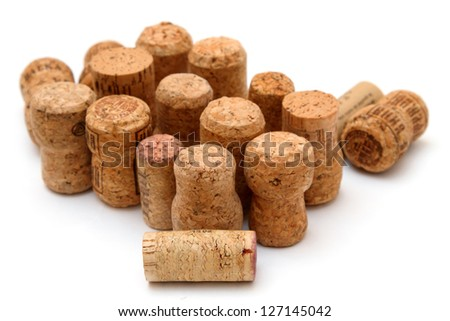many corks from wine and champagne on the white background - stock photo