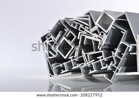 many different aluminum sectional strips in spotlight - stock photo
