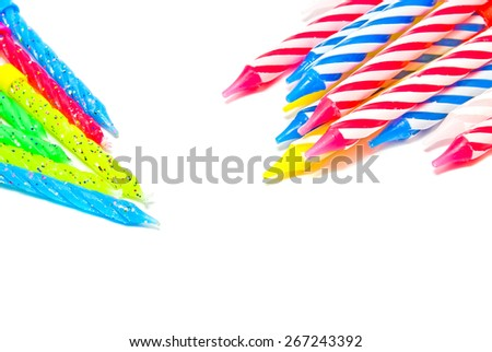 many different candles for cake on white background - stock photo