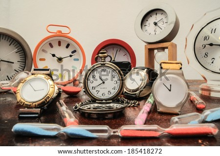 Many Different Clocks on a Woden Table - stock photo