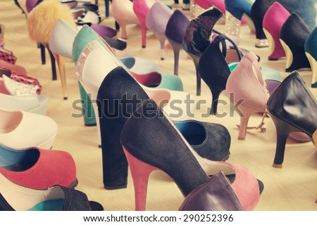 Many different colorful shoes at market - stock photo