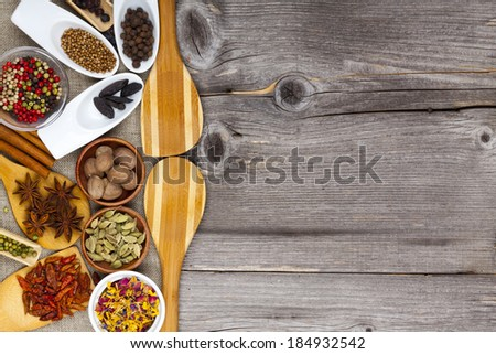 Many different fragrant spices on rustic table