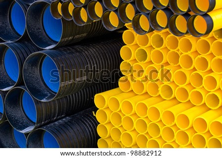 Many different kind of plastic pipes on pile. - stock photo