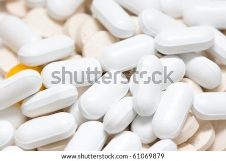 many different medicine pills macro - stock photo