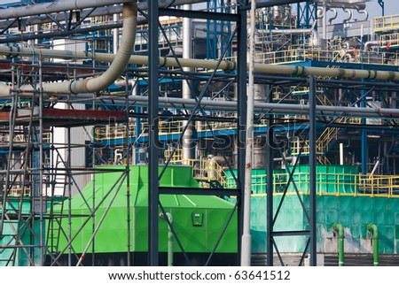 Many different pipelines in a big chemical factory - stock photo