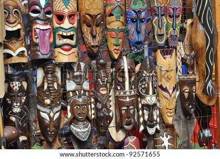 many different tribal masks at a local flea market - stock photo