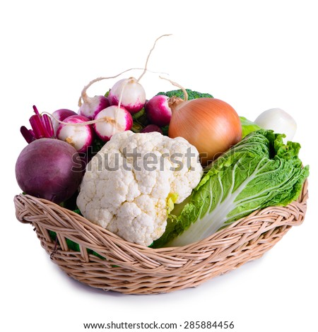 Many different vegetarian vegetables in basket. isolated on white background. large depth of field of the frame - stock photo