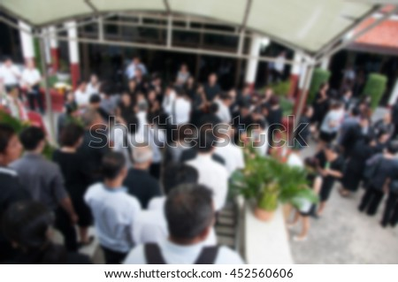 Many distinguished guests to the funeral wearing black to mourn. Blur abstract. - stock photo