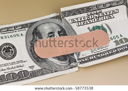 Many dollars banknotes with a band-aid - stock photo