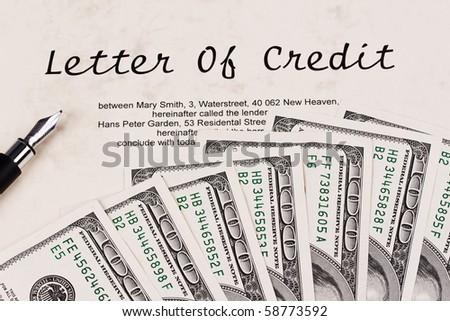 Many dollars bills and English credit - stock photo