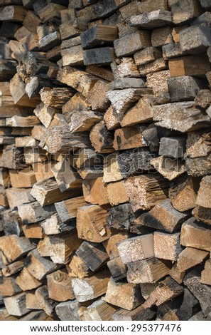 Many dry chopped firewood logs. Vertical.