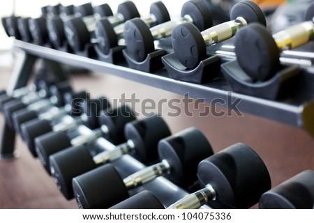 many dumbbells are at  stand at the gym - stock photo