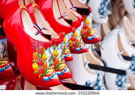 Many dutch wooden shoes - stock photo