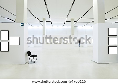 Many empty frames in museum - stock photo