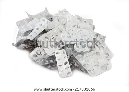 Many Empty Pill Blister Packages. Isolated on a White Background. - stock photo