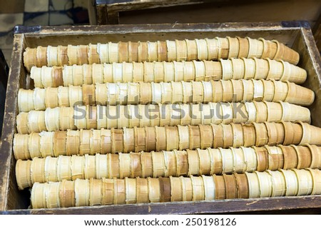 Many empty waffle cones for ice cream in a box - stock photo
