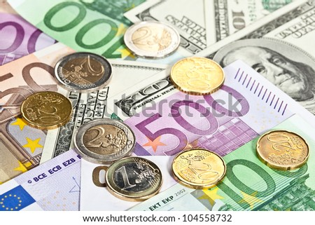 Many euro and dollar banknotes and coins, money background - stock photo