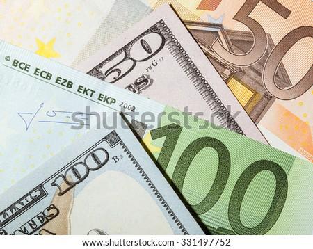 Many euro and dollar banknotes - closeup shot - stock photo