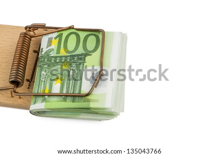 many euro bank notes in mousetrap. symbolic photo for debt and debt with credit. - stock photo