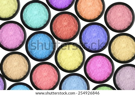 many eyeshadows on white background - stock photo