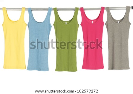 Many female shirt  hanging on wooden hangers