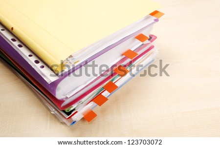Many files and sticky notes on a desk - stock photo