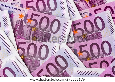many five hundred euro banknotes are adjacent. symbolic photo for wealth and investment - stock photo