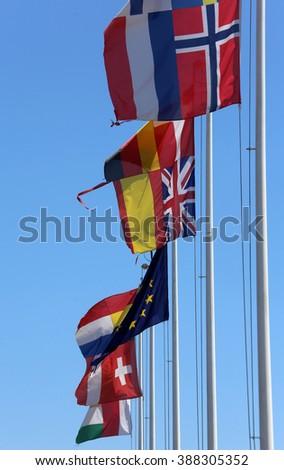 many flags of many nations world waving - stock photo