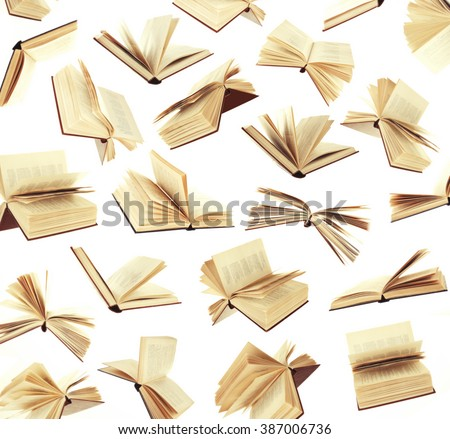 Many flying books as background isolated on white - stock photo