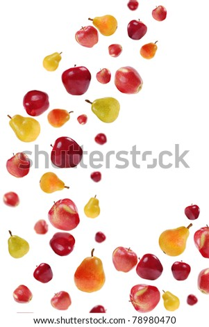 many flying red apples and colorful pears on white  background