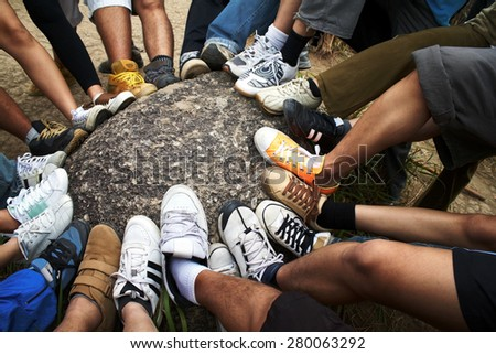 Many foot to show solidarity strength - stock photo