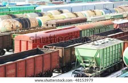 Many freight wagons on city cargo terminal - stock photo