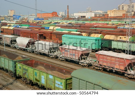 Many freight wagons on city cargo terminal - stock photo
