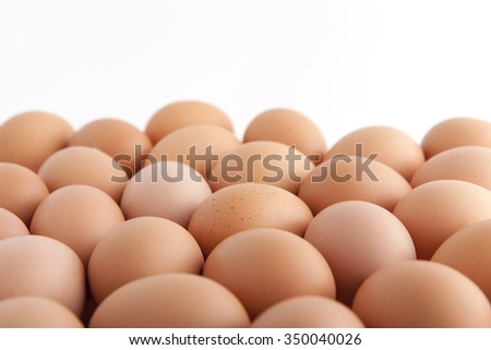many fresh brown eggs   on white background