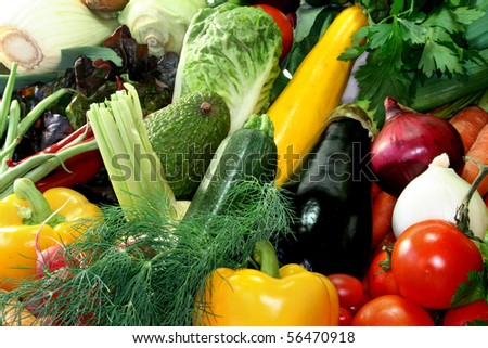 many fresh, different types of vegetables stacked in a pile - stock photo