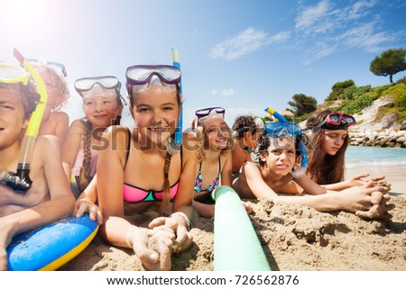 Many friends together have fun on the beach