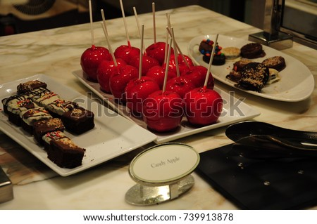 https://thumb9.shutterstock.com/display_pic_with_logo/167494286/739913878/stock-photo-many-fruit-desserts-739913878.jpg