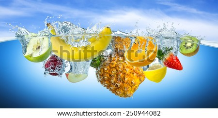 many fruits splashes into water - stock photo