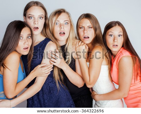 many girlfriends hugging celebration on white background, smiling talking chat close up
