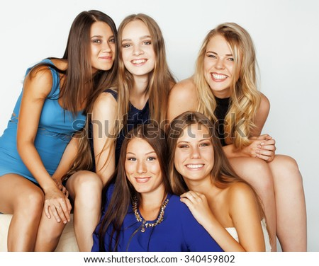 many girlfriends hugging celebration on white background, smiling talking chat, girl next door close up wondering sweety - stock photo