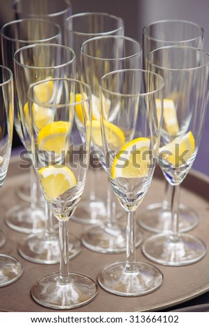 Many glass with lemon Prepare for cocktail - stock photo
